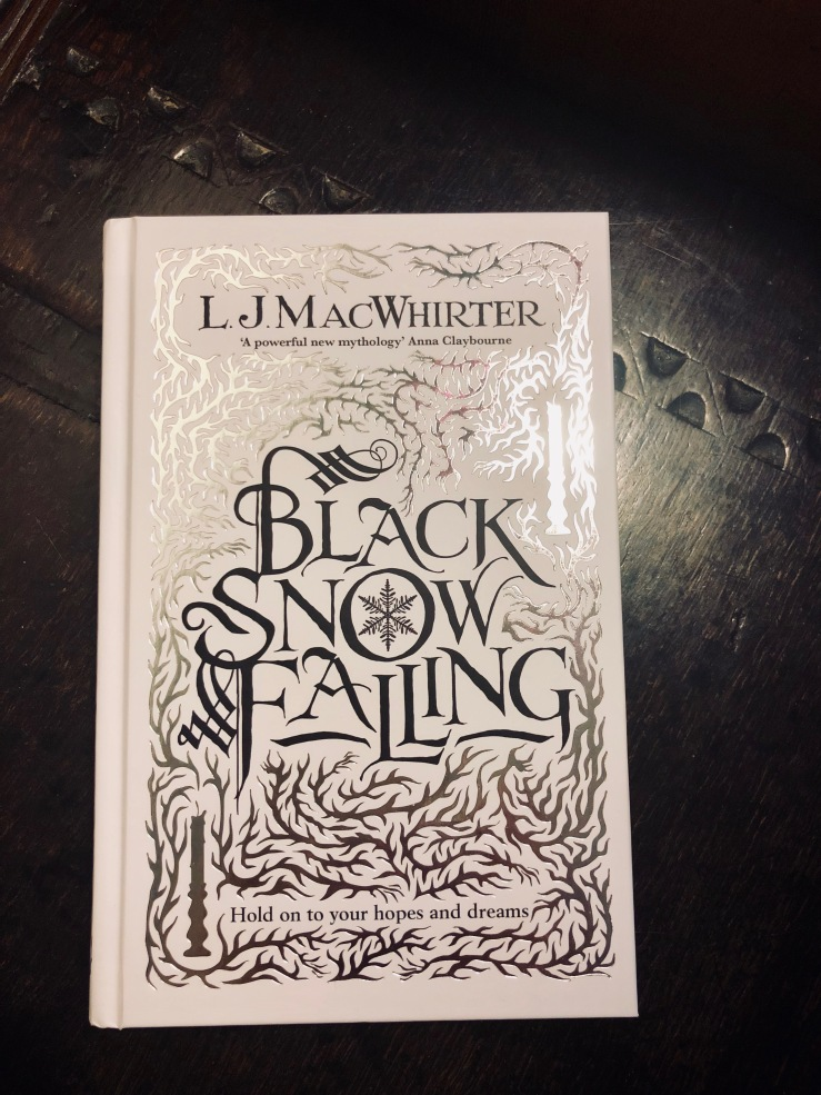 Black Snow Falling by L.J. MacWhirter on a tudor box
